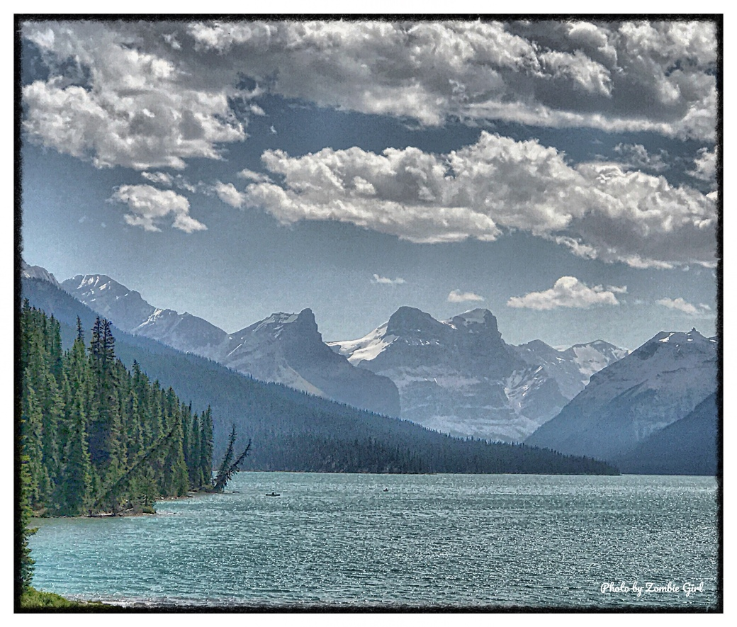 A view of the glaciers in the distance across Maligne Lake