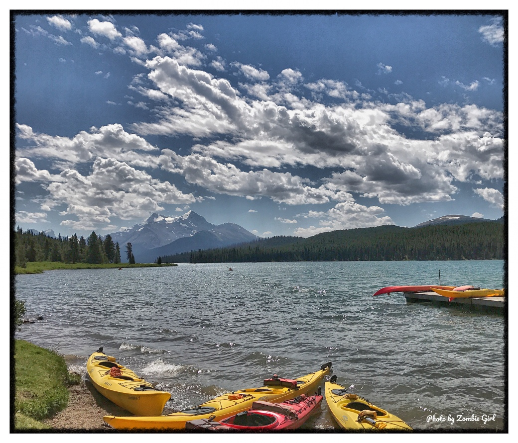 Canoes on the bank of Maligne Lake