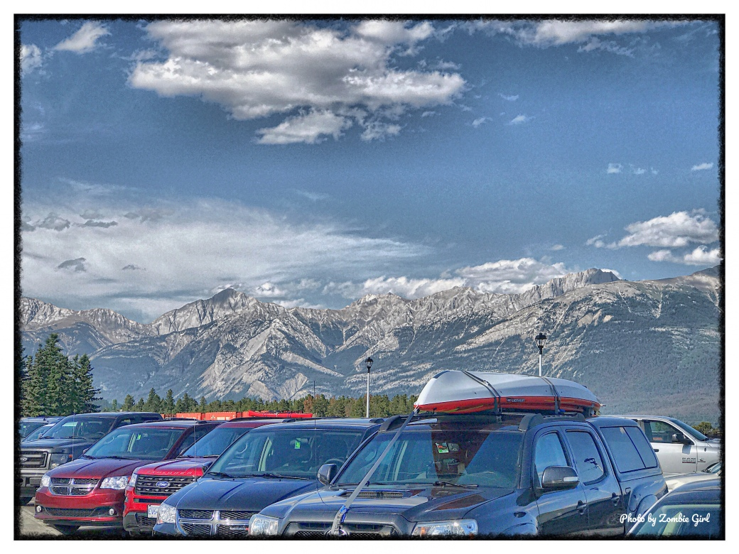 Set against the cars, the backdrop of the Canadian Rockies looked like a cardboard cut out.